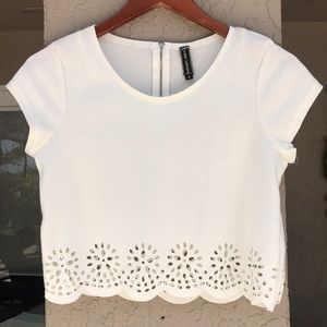 Poof Couture top with floral cut out hem.